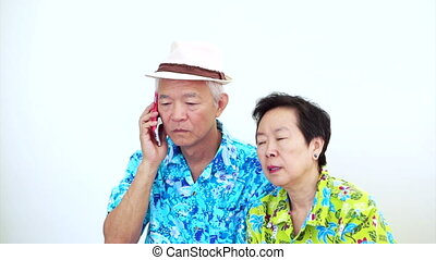 Asian couple angry on the phone