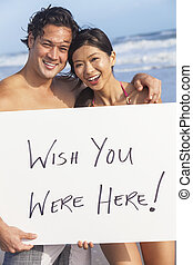 Asian Couple at Beach Wish You Were Here - Man & woman Asian...