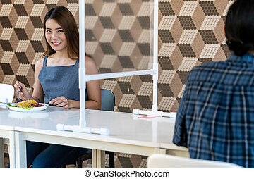 Asian couple eating out new normal cafe