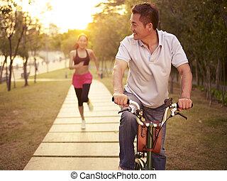 asian couple enjoying outdoor activities - young asian...