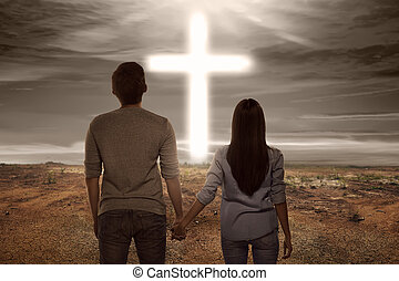 Asian couple holding hand each other looking bright cross ...