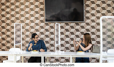 Asian couple in new normal restaurant