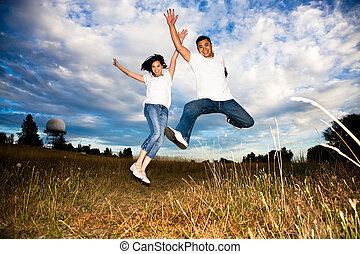 Asian couple jumping for