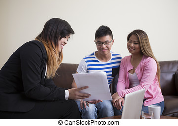 Asian couple meeting financial adviser. - Asian couple...