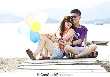 Asian couple on wooden bridge