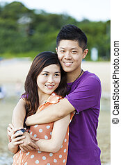 Asian couple smiling