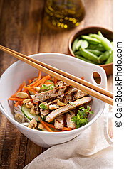 Asian cuisine chicken salad with rice noodles, carrot and ...