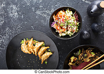 Asian cuisine dishes on the table overhead view - Asian ...