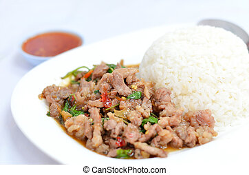 asian cuisine - rice and pork fried with chili pepper and ...