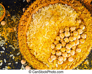 Asian cuisine, spices, rice, chickpeas and turmeric on a plate