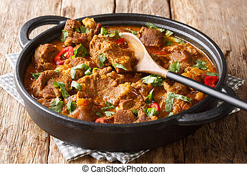 Asian cuisine traditional Lamb rogan josh with spices and ...