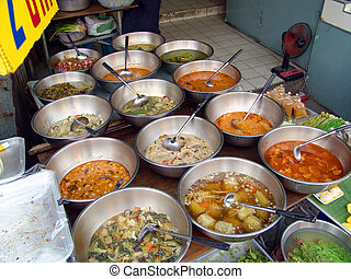 asian cuisine - Variety of asian soups in steel dishes.