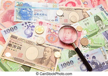 asian currency, magnifying glass and Background of asian ...