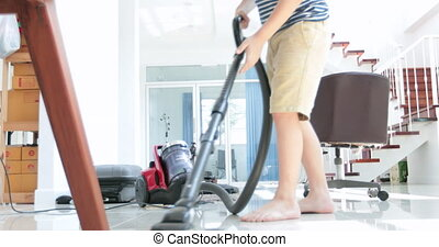 Asian cute boy doing your hose housework, housekeeping, and...
