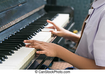 Asian Cute Girl Playing Piano At Home.