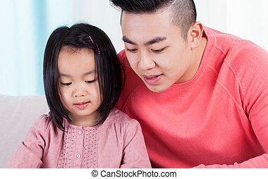 Asian dad spending time with daughter