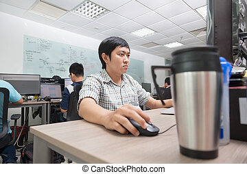 Asian Developer Using Laptop Computer Sitting Working Real Office