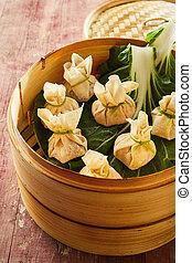 Asian dim sum dumplings in bamboo basket