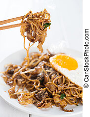 Asian dish stir fried Char Kuey Teow - Close-up stir fried...