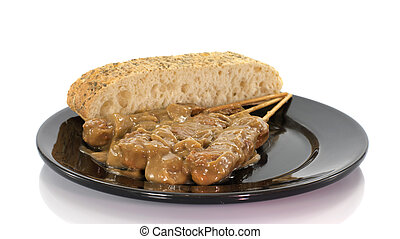 asian dish with bread and sate