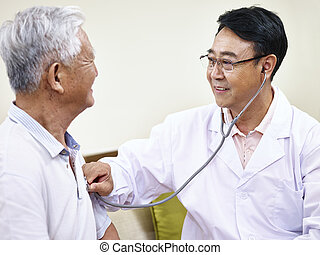 asian doctor checking senior patient