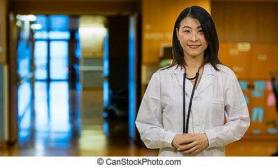 Asian doctor in hospital hallway
