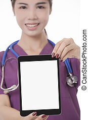 Asian doctor or nurse holding tablet computer isolated on a white background