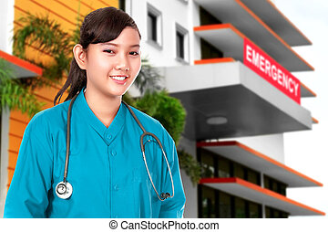 Asian Doctor woman with stethoscope standing in front of the emergency room