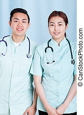 Asian doctors in medical apron with stethoscope