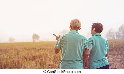 Asian elderly couple at farm rice field business happy nature lifestyle