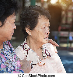 Asian elderly women chatting