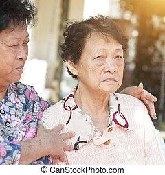 Asian elderly women chatting outdoor