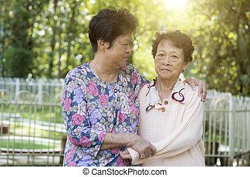 Asian elderly women friends