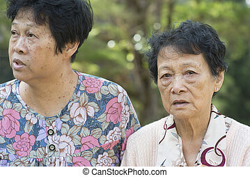Asian elderly women talking at outdoor