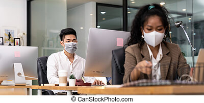 Asian employee face mask in new normal office - Panorama ...
