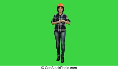Asian engineer with helmet talk to a camera on a Green Screen, Chroma Key