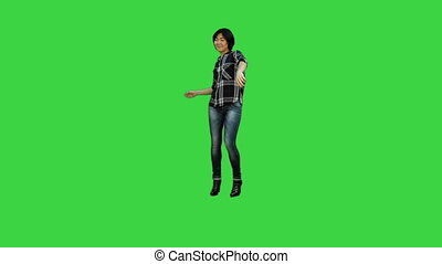 Asian engineer woman with blueprints and orange helmet on a Green Screen, Chroma Key