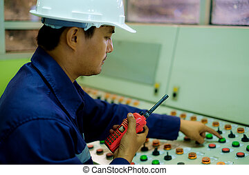 Asian engineer working in the control room