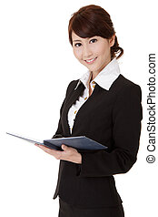 Asian executive woman smiling and looking at you holding...