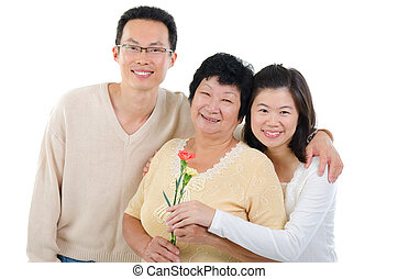 Asian family celebrates Mothers Day. Adult offspring giving...