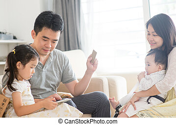 Asian family doing online shopping