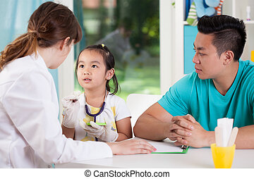 Asian family during medical appointment - View of asian...