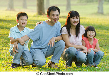 asian family enjoying outdoor at the park