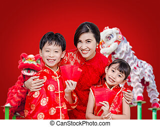 Asian family in chinese traditional dress holding red packet...