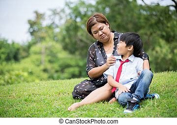 Asian family ,mother with her son at park