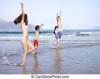 asian family on beach