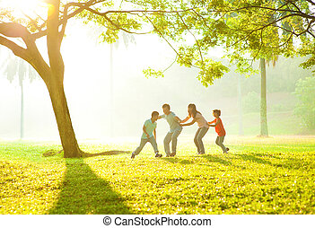Asian family outdoor fun - Happy Asian family playing...