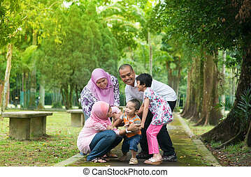 Asian family playing outdoor