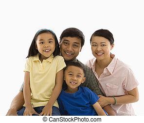 Asian family portrait. - Asian family portrait against white...