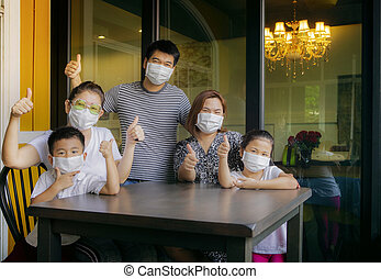 asian family quarantine at home while corona virus ,covid-19...